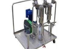 Skid-mounted-hygienic-filtration-system-with-butterfly-valves-and-diaphragm-pump.
