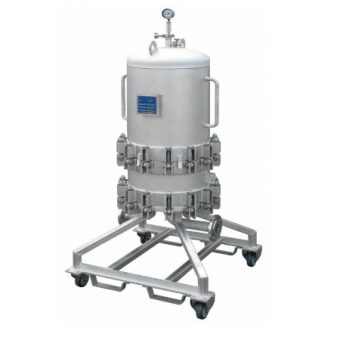 Mobile filter housing for corrosive industrial chemicals.